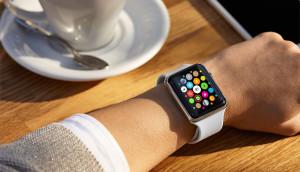 An apple watch on a wrist.