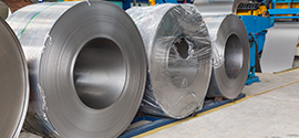 Rolls of steel sheet metal ready to be molded